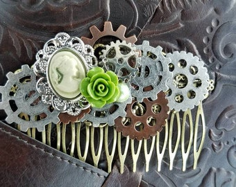 Romantic steampunk hair comb featuring a statement Victorian ivory silhouette, bronze/copper/silver gears with light green pearl and flower