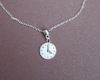 "Silver-plated clock necklace with 8"" chain."