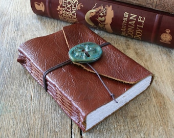 "Leather Journal . Pearl Buck quote: ""Inside myself is a place where I live alone..."" handbound . copper brown & ceramic button (320pgs)"
