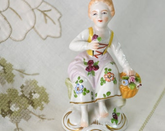 """Sitzendorf Porcelain Figurine .. Woman or Child Flower Seller .. Small Figure .. Blue Back Stamp ..Made in Germany .. 9.5cm / 3 1/2"""""""