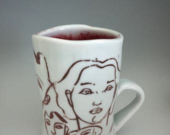 Faces Porcelain Cup