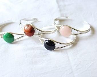 Galaxy bracelet with round cabochon gemstone.