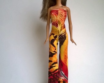 Barbie jumpsuit in warm red / orange tones with an interesting pattern