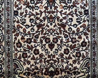 Turkish prayer mat/rug in browns and yellows with traditional design.