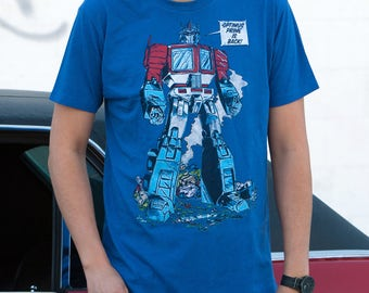 Transformers Optimus Prime Is Back (TRS0070-511HBL) Men's T-Shirt. Autobots, robots, Hasbro, comics, Optimus, Roll Out, 80's, Megatron