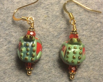 Small red and green lampwork frog bead earrings adorned with orange red Chinese crystal beads.