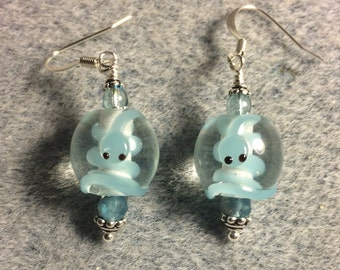 Clear and light turquoise lampwork coiled snake bead earrings adorned with light turquoise Czech glass beads.