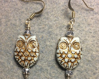 Light blue with gold wash Czech glass owl bead earrings adorned with light blue Chinese crystal beads.