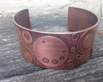 Handcrafted etched copper cuff with circular design