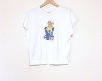 Kitten in a bucket, graphic print tee. Off-white, cream color, soft and comfy cotton top.