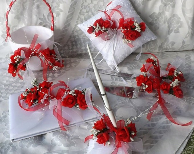 Flower girl basket, guest book , pen, flutes , cake and knive server wedding accesoriers