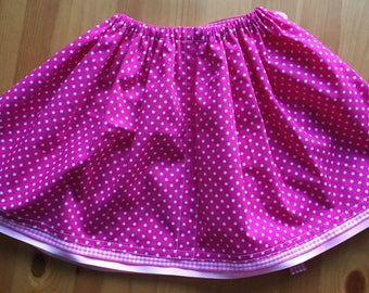 Toddlers cerise pink with white dots drawstring skirt.