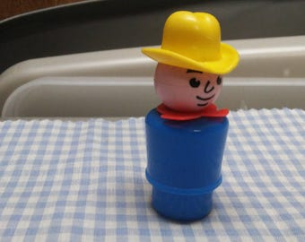 Fisher Price Farmer with blue base, yellow hat and red handkerchief