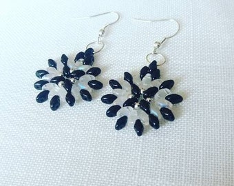 Beautiful unique handmade earrings in shades of frosted crystal and jet black with silver seedbeads.