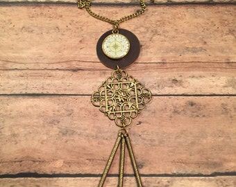 Clock pendant with gold tassle