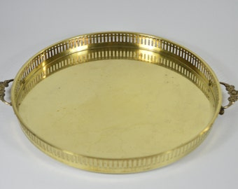 Golden metal brass with decorative handles tray round of 32 cm