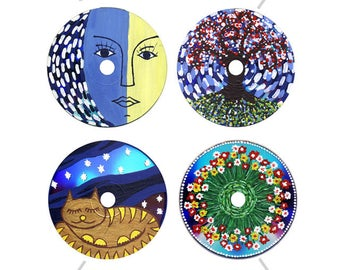 Pictures and mandalas on DVD are a master class. Collection of the phased creation of 4 pictures on DVD-disks. Painting on DVD with acrylic