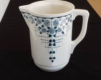 St. Ghislain, Belgium, 1830: large airbrushed 'spritzdekor' water pitcher with blue-grey flowers