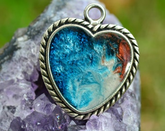 Heart shaped blue and pink resin pendant