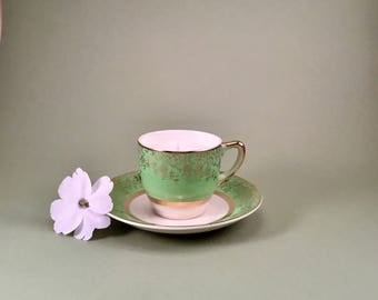 Soy candle hand poured in a small green and gold vintage teacup