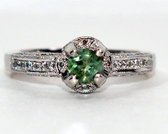 Stunning 3 25tcw Colombian Emerald Amp Sapphire By