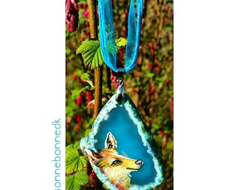 Agate slice wolf painted pendant on organza cord.