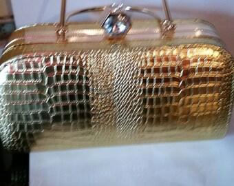 A women gold colour elegant clutch purse handbag medium size