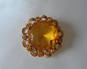 gold tone brooch faceted glass marmalade colour