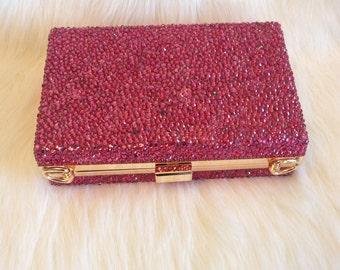 Acrylic bag with pink rhinestones and gold trim
