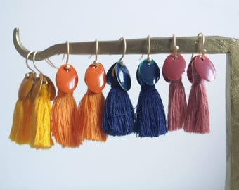 Pom poms and badges. Long earrings of PomPoms. Different colors.