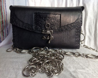 Handmade, handtooled, black Leather purse with a classy chain strap!