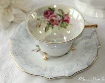 Japan: Lusterware footed tea cup and saucer with loopful handle