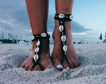 Black barefoot sandals with real sea cowrie shells and silver beads.