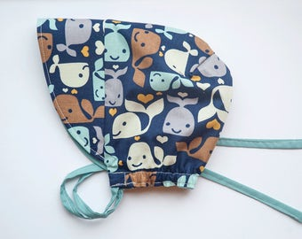 Baby and toddler reversible bonnet – Whales to tails