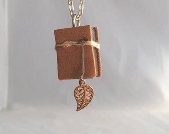 mini book necklace, book jewelry, book pendant, book charm, wood book with brown leather cover, hemp cord, leaf charm. teacher gift