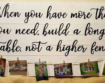 When you have more than you need, build a longer table,  not a higher fence with photo clips wood sign