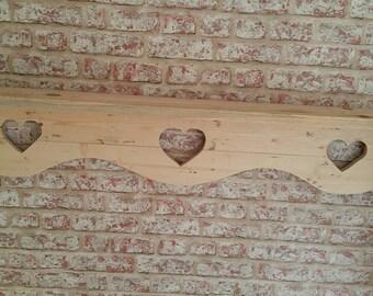 Handmade shelf with heart design