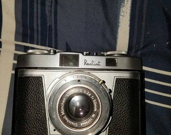 Realist 50mm camera and leather case and on the back of a leather case and camera says  made in Germany on them