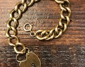 Vintage 1940s solid 14k yellow gold heart padlock chain link bracelet