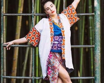 White Kimono with African printed sleeves and colar and a handpainted koi fish in the back