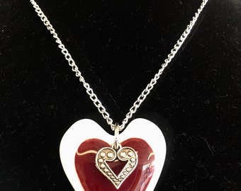 Glass fired heart with metal heart