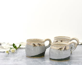 Rustic ceramic mug with bird images glazed in shades of moss green to misty blue to creamy white - handmade stoneware pottery