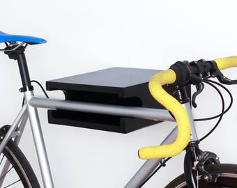 Bike rack in lacquered black poplar wood