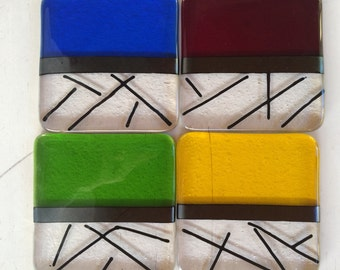 Red, yellow, green and blue fused glass coasters