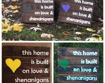 This home is built on love and shenanigans.. wood sign