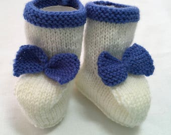 Hand Knitted Booties in White with  Blue accents.