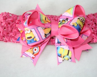 Boutique Ribbon bow on a crocheted Interchangable  headband ......   Minions #3 with pink  on Pink...