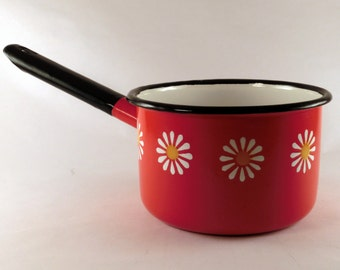 Vintage red enamel pot with a flower decor