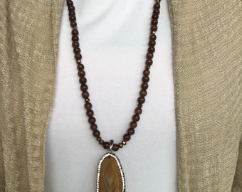 Long Brown Shimmering Pendant Necklace