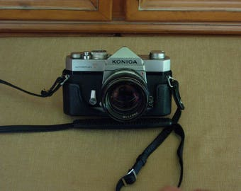 Konica Autoreflex T 35mm SLR Camera with 57mm f1.4 Konica Hexanon Lens and Bottom portion of Case
